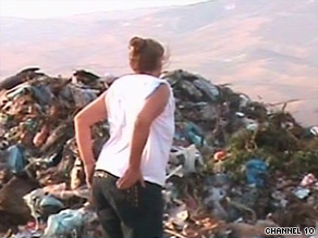 A woman scours a garbage heap in Tel Aviv for missing mattress.