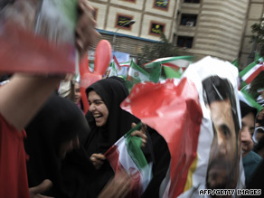 Supporters of President Ahmadinejad wave flags at a massive rally in Tehran Sunday to celebrate his victory