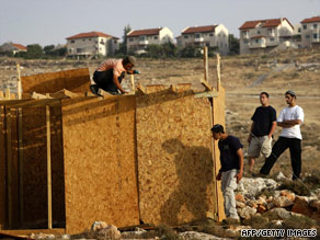 Settlers rebuild a structure on June 9 destroyed by Israeli security forces near Kokhav Ha Shahar settlement.