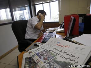A foreign journalist speaks on the phone Wednesday in Tehran.