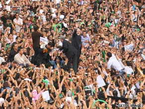 Mir Hossein Moussavi, center, is surrounded by supporters in Tehran, Iran, on Thursday.
