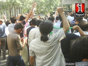 Iranians protest Tuesday in Tehran despite a heavy security presence.