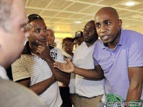 Relatives react at Marseille airport in France after being informed of the list of the passengers' names.