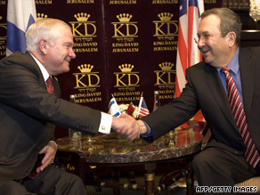 U.S. Defense Secretary Robert Gates, left, shakes hands with his Israeli counterpart Ehud Barak.