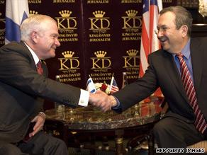U.S. Defense Secretary Robert Gates, left, shakes hands with his Israeli counterpart Ehud Barak.