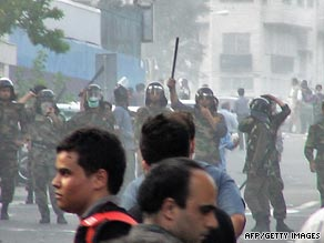 Iranian riot police block protesters on a Tehran street in June.