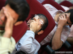 Iranian opposition suspects cover their faces at a Revolutionary Court hearing in Tehran last week.