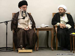 Ayatollah Ali Khamenei speaks during the announcement  that Sadeq Larijani, right, twill head Iran's judiciary.