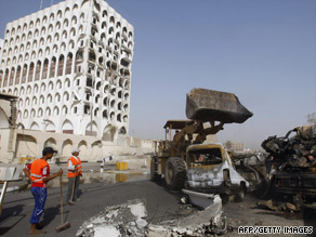 Workers clear up the site outside the ministries of finance and foreign affairs in Baghdad.
