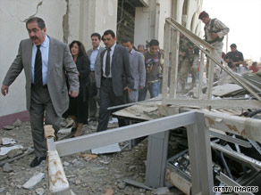 Iraqi Foreign Minister Hoshyar Zebari inspects damage to his building after Wednesday's bombing.