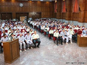 Suspected opposition supporters (in grey) attend their trial in Tehran, Iran, on August 16.