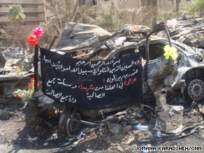 Plastic flowers decorate a car destroyed in last week's bombings in Baghdad, Iraq.