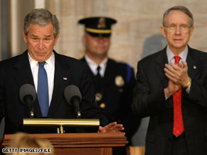 Sen. Harry Reid, pictured here with Pres. Bush in an April 2008 file photo, stood by his persistent criticism of the 43rd president in an interview Sunday.