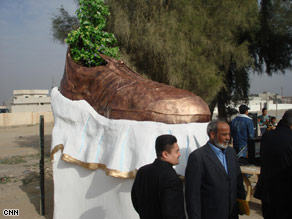 Iraqi orphans helped a sculptor create this monument to the shoe thrown at former President Bush last month during a visit to Baghdad.