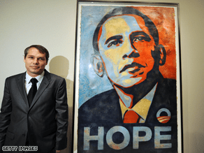 Fairey stands next to his famous depiction of Obama at the National Portrait Gallery.