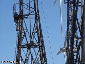 Technicians climb wind turbines in Tehachapi, CA.