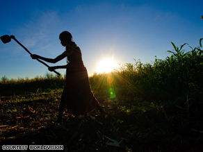 In Turkana, Kenya, a woman hoes the fields in preparation for planting. At the G-20 this week, President Obama promised to double U.S. aid for global agricultural development.