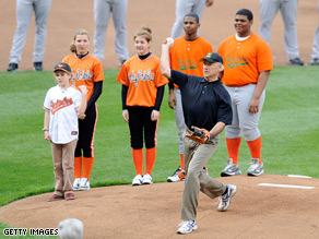 The vice president lobbed a high ball to catcher Chad Moeller to kick off the O's season.