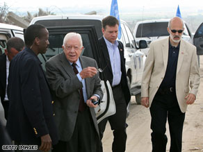 Former President Jimmy Carter arrives in the Ezbet Abed Rabbo district of Jabalia in the northern Gaza Strip.