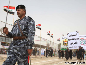 Iraqi soldiers join in a parade Tuesday in Karbala to mark the withdrawal of U.S. troops from cities and towns.