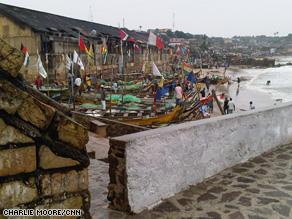 Boats along the shore of Ghana's coast.