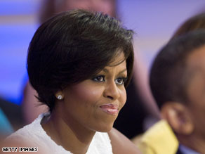 Michelle Obama's new summer 'do is drawing comparisons to a certain former First Lady's bob.