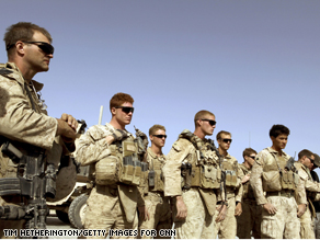 U.S. Marines listen to a brief before heading out on patrol in Helmand Province.