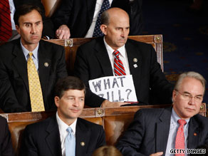 One Republican member of Congress holds up a sign during President Obama's speech to Congress Wednesday night