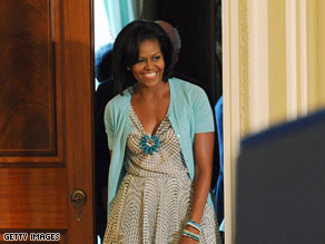 First Lady Michelle Obama challenged chefs on an upcoming episode of Iron Chef America.