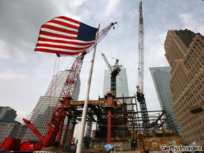 An American flag flies in front of the construction site of the former World Trade Center site on September 8, 2009.