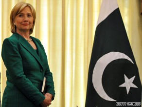 Secretary of State Clinton, pictured here with the Pakistani flag, is overseas meeting with Pakistani officials.