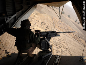 Inside a C-130 on the trip to Helmand province.
