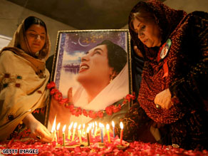 Supporters light candles in front of a picture of slain former Pakistan premier Benazir Bhutto on the second anniversary of her death.