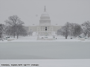 The Capitol Building is seen across from a partially frozen pool in D.C. A huge blizzard dumped a blanket of snow over the nation's capitol.
