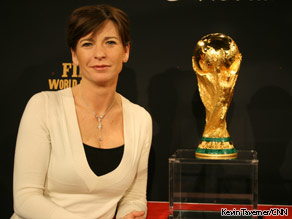 CNN's Becky Anderson poses for a picture with the World Cup trophy