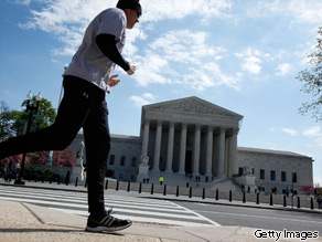 A jogger passes by the U.S. Supreme Court April 9, 2010 in Washington, DC.