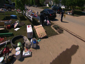 Front lawns are strewn with waterlogged possessions basking in the sun; it looks like entire neighborhoods are having yard sales.