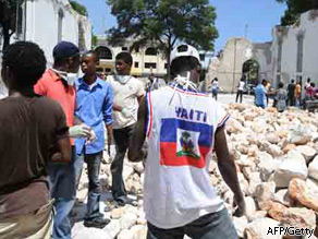 Students help to clear the rubble of the Anglican Cathedrale Episcopale Sainte Trinite in Port-au-Prince, Haiti, on Saturday.