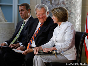 Former GOP House Speaker Dennis Hastert, center, spoke with CNN Tuesday about his Democratic successor Speaker Nancy Pelosi, foreground, and the upcoming midterm elections.