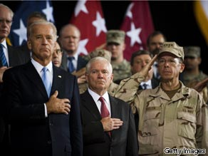 BAGHDAD - SEPTEMBER 1: U.S. Vice President Joe Biden (L), U.S. Secretary of Defense Robert Gates (C) and Chairman of the Joint Chiefs Admiral Mike Mullen (R) stand during the U.S. national anthem during U.S. Forces-Iraq change of command ceremony September 1, 2010 in Baghdad, Iraq.
