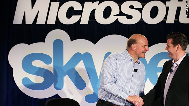 Microsoft CEO Steve Ballmer, left, and Skype CEO Tony Bates shake hands at a news conference Tuesday.