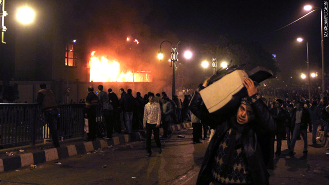 Many Egyptians defied a government curfew Friday night and faced stinging police tear gas as they marched for change.
