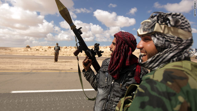 Libyan rebels deploy near the city of Ajdabiya to try to attack government forces that have encircled the town.