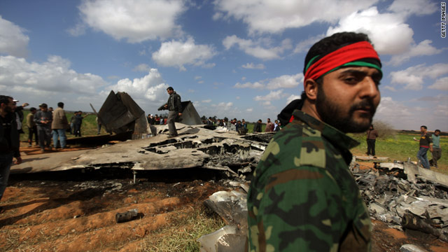 Libyans gather around the wreckage of a US F-15 fighter jet in Ghot Sultan, south-east of Benghazi on March 22nd after crashing while on a mission against Moammar Gadhafi's forces.