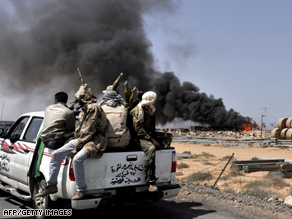 Opposition forces push forward from Bin Jawad toward Moammar Gadhafi's birthplace of Sirte Monday.