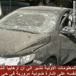 An image grab from Syrian state TV Friday shows a damaged car at the site of a powerful explosion in the heart of Damascus.