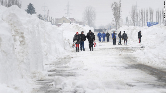 <br/>Freshly plowed snow frames a road in Bucharest, Romania, on Friday, January 27.