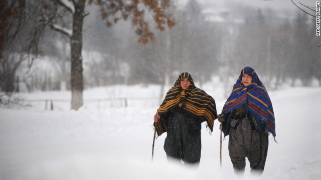 <br/>Bulgarian women walk through heavy snow Saturday, January 28 in Rakovski.