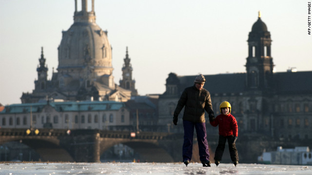 <br/>A boy and his mother skate on the partly frozen Elbe River as the skyline of the eastern German city of Dresden is silhouetted in the background on Thursday, February 2. A cold snap kept Europe in its icy grip, pushing the death toll past 150 as countries from Italy to Ukraine struggled to cope with temperatures that reached record lows in some places.