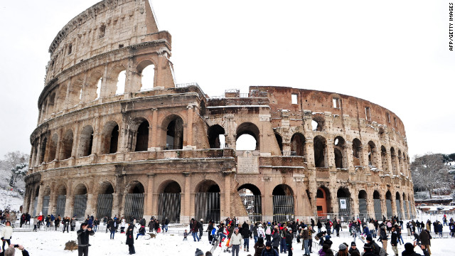 <br/>People stand in snow in front of the Colosseum on Saturday, February 4, in Rome.